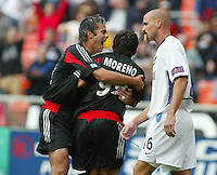 3 April 2004: DC United Mike Petke celebrates Jamie Moreno after Moreno scored a goal during first half against Earthquakes at RFK Stadium in Washington D.C..  Credit: Michael Pimentel / ISI