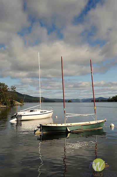 Sailboats in bay.
