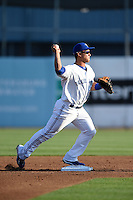 Dunedin Blue Jays  second baseman Christian Lopes (14) attempts to turn a double play during a game against the Brevard County Manatees on April 11, 2014 at Florida Auto Exchange Stadium in Dunedin, Florida.  Brevard County defeated Dunedin 5-2.  (Mike Janes/Four Seam Images)