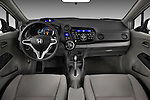 Straight dashboard view of a 2010 Honda Insight.