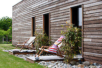 Deckchairs have allocated strips of decking on the garden facade of the house
