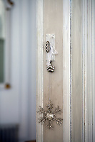 Detail of a snowflake decoration hanging from a door key