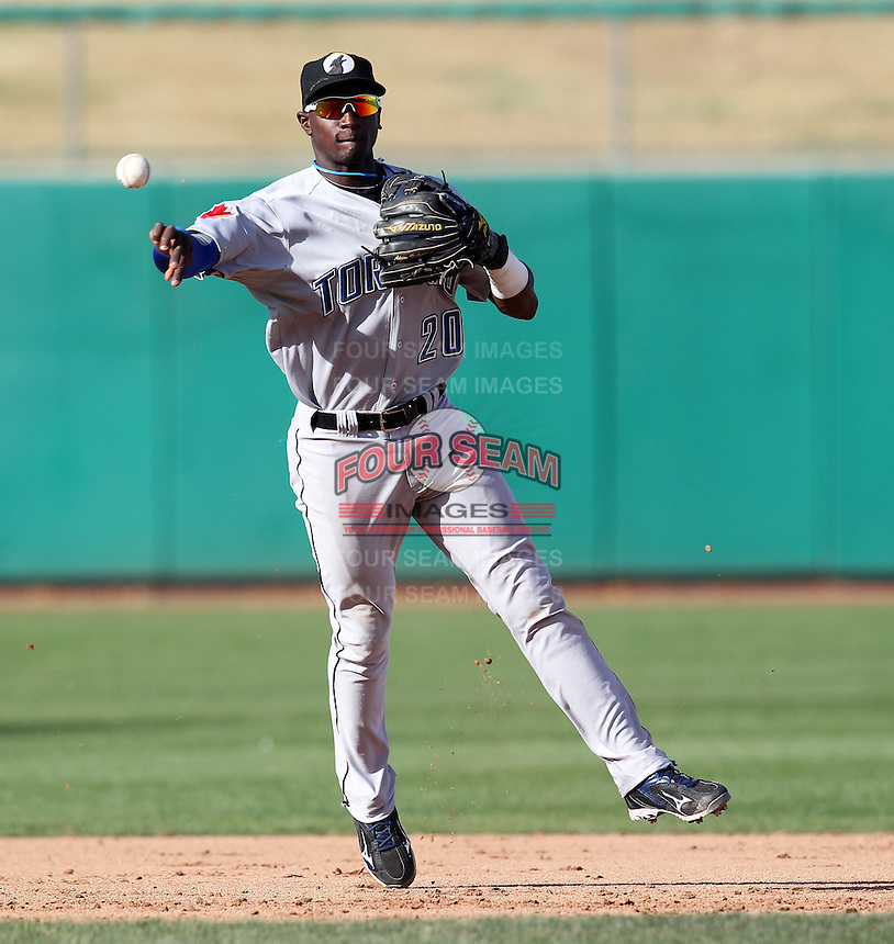 Phoenix Desert Dogs shortstop Adeiny Hechavarria #20 throws to first during an Arizona Fall League game against the Mesa Solar Sox at HoHoKam Park on November 3, 2011 in Mesa, Arizona.  Mesa defeated Phoenix 8-7.  (Mike Janes/Four Seam Images)