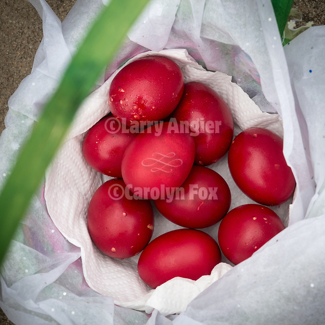 Symbolic red easter eggs.<br /> <br /> Memorial Monday/Побусани Понедељак<br /> <br /> Visiting the cemeteries to clean-up and greeting those who are buried there with Pascal (Easter) eggs and wishing them the joyous call, Christ is Risen!/Христос васкрсе!