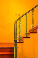A Catholick Church in Macow, China was open to the public and included this stair well colored in the bright yellow and green typical of the Portuguese.