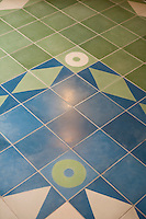 A decorative blue and green tiled floor