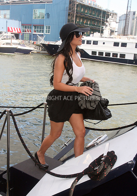 WWW.ACEPIXS.COM . . . . .  ....July 1 2010, New York City....Kim Kardashian boards a yacht at Chelsea Piers on July 1 2010 in New York City....Please byline: RIVERA/VAUGHAN- ACEPIXS.COM.... *** ***..Ace Pictures, Inc:  ..Tel: 646 769 0430..e-mail: info@acepixs.com..web: http://www.acepixs.com