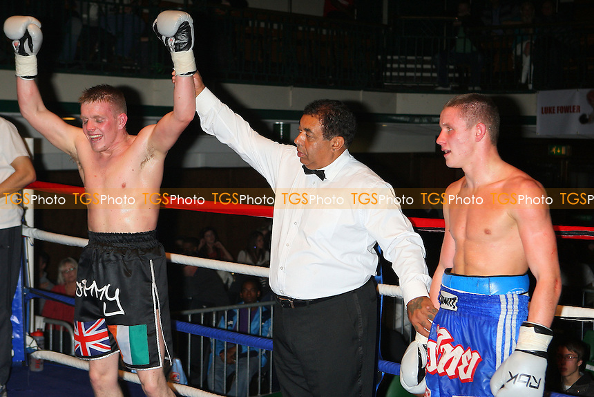 James Coyle (black shorts) defeats Oleksiy Chukov in a Welterweight boxing contest at York Hall, Bethnal Green, promoted by Miranda Carter / Left Jab Promotions - 13/11/11 - MANDATORY CREDIT: Gavin Ellis/TGSPHOTO - Self billing applies where appropriate - 0845 094 6026 - contact@tgsphoto.co.uk - NO UNPAID USE.