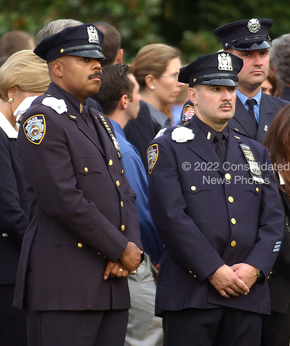Washington, D.C. - September 11, 2004 --  Officers representing the New York City Police Department stand on the south lawn of the White House in Washington, D.C. on September 11, 2004 as United States President George W. Bush and first lady Laura Bush observe a moment of silence marking 3 years from the moment of the first terrorist attack on the World Trade Center in New York on September 11, 2001.<br /> Credit: Ron Sachs / CNP