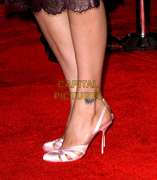 ZULEIKHA ROBINSON.The World Premiere of Hidalgo held at The El Capitan Theatre in Hollywood, California .01 March 2004.*UK Sales Only*.feet, pink satin slingback shoes heels stilettos, tattoo, legs.www.capitalpictures.com.sales@capitalpictures.com.©Capital Pictures.