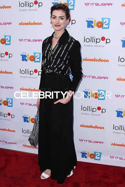 """BURBANK, CA, USA - APRIL 26: Actress Anne Hathaway arrives at the Lollipop Theater Network's Night Under The Stars Screening Of Twentieth Century Fox's """"Rio 2"""" Hosted by Anne Hathaway held at Nickelodeon Animation Studios on April 26, 2014 in Burbank, California, United States. (Photo by Xavier Collin/Celebrity Monitor)"""