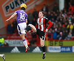 John Lundstram of Sheffield Utd challenges Josh Cullen of Bolton Wanderers during the Championship match at Bramall Lane Stadium, Sheffield. Picture date 30th December 2017. Picture credit should read: Simon Bellis/Sportimage