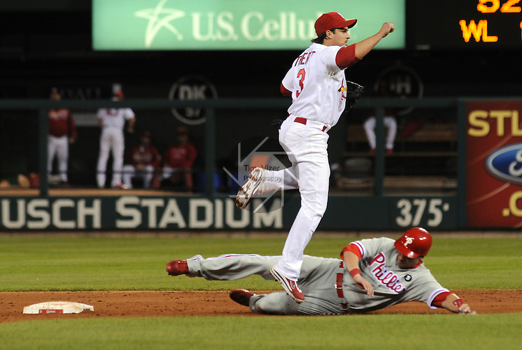 16 May 2011                              St. Louis Cardinals shortstop Ryan Theriot (3) jumps over Philadelphia Phillies first baseman Ross Gload (7) as he slides into second base, as Theriot throws to first base for the double play. The St. Louis Cardinals defeated the Philadelphia Phillies 3-1 on Monday May 16, 2011 in the first game of a two-game series at Busch Stadium in downtown St. Louis.