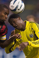 Eddie Pope of the MetroStars goes for a header against Edson Buddle of the Columbus Crew. The Crew defeated the MetroStars 1-0 on 4/12/03 at Giant's Stadium, East Rutherford, NJ.