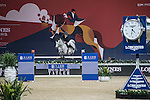 Roger-Yves Bost of France riding Pegase du Murier competes during the Longines Grand Prix, part of the Longines Masters of Hong Kong on 12 February 2017 at the Asia World Expo in Hong Kong, China. Photo by Juan Manuel Serrano / Power Sport Images