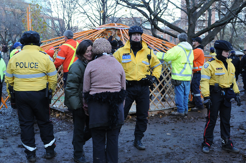 November 23, 2011, wrapping up the eviction, Toronto City workers, surrounded by police, protest supporters and media people, dismantle the library yurt, the last remaining Occupy Movement structure at St. James Park.  The Toronto Police Service, municipal works staff and protest coordinators are all winning high praise for an orderly, respectful and safe transition of the park.