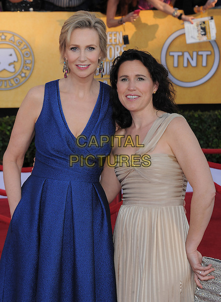 Jane Lynch & Dr. Lara Embry.18th Annual Screen Actors Guild Awards held at The Shrine Auditorium, Los Angeles, California, USA..January 29th, 2012.SAG SAGS half length blue dress sleeveless beige one shoulder couple.CAP/RKE/DVS.©DVS/RockinExposures/Capital Pictures.