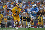 29 MAY 2011:  Ryan Clarke (4) of Salisbury University moves the ball against Sam Diss (30) of Tufts University during the Division III Men's Lacrosse Championship held at M+T Bank Stadium in Baltimore, MD.  Salisbury defeated Tufts 19-7 for the national title. Larry French/NCAA Photos