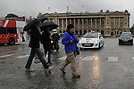 Beth walking in the rain at Place de la Concorde and Avenue da la Champs Elysees, Paris, France.