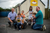 Friday  12 August 2016<br /> Pictured: Admin staff and funding manager Emyr Beynon (R) and Amazon manager Pat Faulkner (L) with Carmarthen Breakthro children L-R Lewis, Ethan, Hari and Kia <br /> Re: The Amazon team in Swansea has made a recent donation of £1,000 to Carmarthen Breakthro charity. The Amazon team are visited the charity to learn more about what they do and how they plan to use the money.