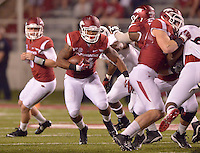 STAFF PHOTO BEN GOFF  @NWABenGoff -- 09/20/14 <br /> Arkansas fullback Kody Walker carries the ball during the fourth quarter of the game against Northern Illinois in Reynolds Razorback Stadium in Fayetteville on Saturday September 20, 2014.