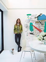 TV presenter Trinny Woodall with her terrier in the dining area of her London home