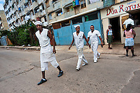"Cuban cooks walk out of the cafeteria in the apartment block in Alamar, a public housing periphery of Havana, Cuba, 9 February 2011. The Cuban economic transformation (after the revolution in 1959) has changed the housing status in Cuba from a consumer commodity into a social right. In 1970s, to overcome the serious housing shortage, the Cuban state took over the Soviet Union concept of social housing. Using prefabricated panel factories, donated to Cuba by Soviets, huge public housing complexes have risen in the outskirts of Cuban towns. Although these mass housing settlements provided habitation to many families, they often lack infrastructure, culture, shops, services and well-maintained public spaces. Many local residents have no feeling of belonging and inspite of living on a tropical island, they claim to be ""living in Siberia""."
