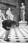 Washington DC USA. 1969. A tourist guide cups her hands and whispers talking to the grounds to demonstrate how her voice carries to the other side of the room in the Capitol building.