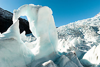 Beautiful icy arch aptly called by glacier guides iris, Franz Josef Glacier, Westland Tai Poutini National Park, West Coast, UNESCO World Heritage Area, New Zealand, NZ