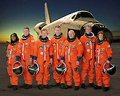 Houston, TX -  April 5, 2006 -- These seven astronauts take a break from training to pose for the STS-121 crew portrait. From the left are astronauts Stephanie D. Wilson, Michael E. Fossum, both mission specialists; Steven W. Lindsey, commander; Piers J. Sellers, mission specialist; Mark E. Kelly, pilot; European Space Agency (ESA) astronaut Thomas Reiter of Germany; and Lisa M. Nowak, both mission specialists. The crewmembers are attired in training versions of their shuttle launch and entry suit..Credit: NASA via CNP