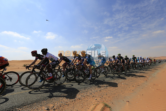 The peloton ride through desert landscape of Jebel Maleihah during Stage 1, the Dubai Silicon Oasis Stage, of the 2016 Dubai Tour starting at the Dubai International Marine Club and running 175km to Fujairah, Mina Seyahi, Dubai, United Arab Emirates. 3rd February 2016.<br /> Picture: Eoin Clarke | Newsfile<br /> <br /> <br /> All photos usage must carry mandatory copyright credit (&copy; Newsfile | Eoin Clarke)