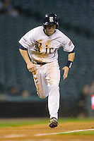Brock Holt #7 of the Rice Owls heads home versus the UCLA Bruins in the 2009 Houston College Classic at Minute Maid Park February 27, 2009 in Houston, TX.  The Owls defeated the Bruins 5-4 in 10 innings. (Photo by Brian Westerholt / Four Seam Images)