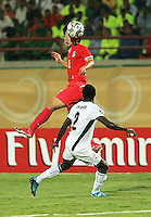 South Korea's Dong Sub Kim (9) makes a header against Ghana's Samuel Inkoom (2) stands on the field before the match against South Korea during the FIFA Under 20 World Cup Quarter-final match between Ghana and South Korea at the Mubarak Stadium  in Suez, Egypt, on October 09, 2009.