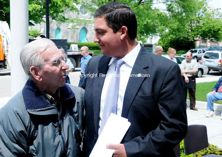 TORRINGTON, CT, 20 MAY 13- 052013AJ04- Torrington Mayor Ryan Bingham speaks with his grandfather Joe Ruwet after announcing he is not seeking reelection in November.   Alec Johnson/ Republican-American