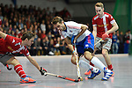 Mannheim, Germany, January 24: During the 1. Bundesliga Herren Hallensaison 2014/15 quarter-final hockey match between Mannheimer HC (white) and Club an der Alster (red) on January 24, 2015 at Irma-Roechling-Halle in Mannheim, Germany. Final score 2-3 (1-2). (Photo by Dirk Markgraf / www.265-images.com) *** Local caption *** Florian Woesch #25 of Mannheimer HC