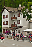 Bike riders pass Hotel Cristallina on Lake Sils, Switzerland near the town of Maloja at the start of the Engadin valley where St. Mortiz is located