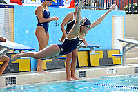 14 January 2012:  One of FIU's swimmers does a belly-flop into the pool as part of a post-meet ritual.  The FIU Golden Panthers won the meet with the Central Connecticut State University Blue Devils at the Biscayne Bay Campus Aquatics Center in Miami, Florida.