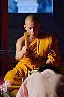 Monk blesssing Buddhist worshipper, Wa Phra That Doi Suthep Rajvoravihara, Chiang Mai, Thailand