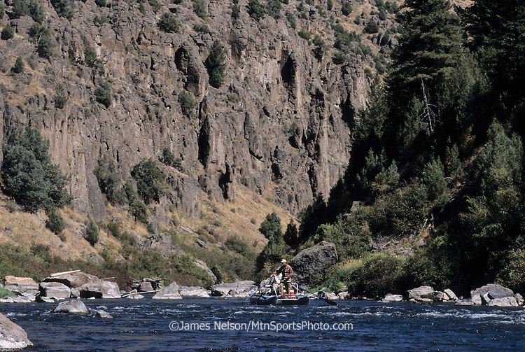 08347-B. An angler fly fishes for trout while floating in a cataraft through the Teton River Valley of Idaho.