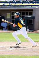 David DeJesus #12 of the Oakland Athletics bats in an intrasquad game during spring training workouts at Phoenix Municipal Stadium on February 24, 2011  in Phoenix, Arizona. .Photo by:  Bill Mitchell/Four Seam Images.
