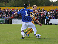 Anestis Areyriou or Rangers and Simon Allan of Forres tackle in the Forres Mechanics v Rangers William Hill Scottish Cup 2nd Round match, at Mosset Park, Forres on 29.9.12...