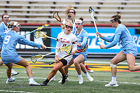 College Park, MD - February 24, 2019: Maryland Terrapins attack Caroline Steele (11) gets hit by several North Carolina Tar Heels defenders during the game between North Carolina and Maryland at  Capital One Field at Maryland Stadium in College Park, MD.  (Photo by Elliott Brown/Media Images International)