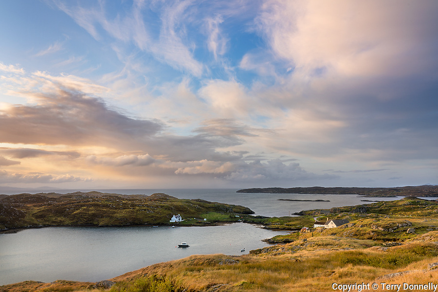 South Harris, Isle of Lewis and Harris, Scotland:<br /> Clearing morning storm clouds over an isolated coastal village