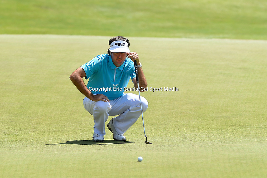 June 22, 2014 - Cromwell, Connecticut - Bubba Watson studies his putt on the 15th green during the final round of the PGA Travelers Championship tournament held at TPC River Highlands in Cromwell, Connecticut.  Eric Canha/CSM