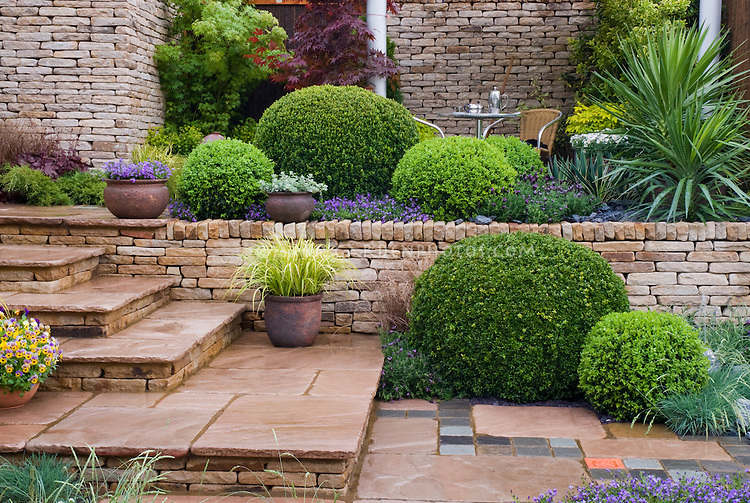 Curb appeal gardening with shrubs perennials container plants and flowers trees stone