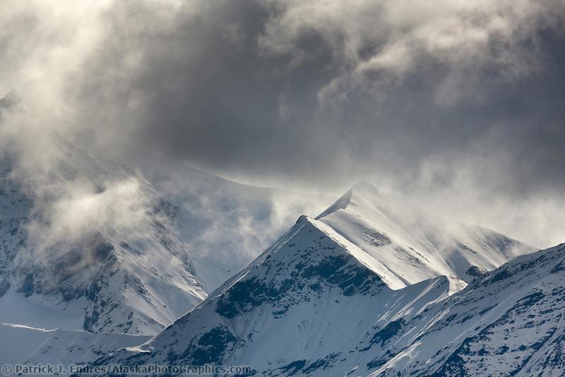 Clouds obscure Alaska Range mountains in Denali National Park, Interior, Alaska.
