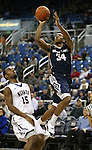 Utah State's Chris Smith (34) shoots past Nevada defender D.J. Fenner (15)during an NCAA college basketball game in Reno, Nev., on Tuesday, Jan. 20, 2015. (AP Photo/Cathleen Allison)
