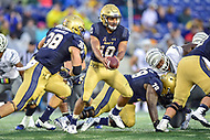 Annapolis, MD - September 8, 2018: Navy Midshipmen quarterback Malcolm Perry (10) hands the ball of to Navy Midshipmen fullback Anthony Gargiulo (38) during game between Memphis and Navy at  Navy-Marine Corps Memorial Stadium in Annapolis, MD. (Photo by Phillip Peters/Media Images International)
