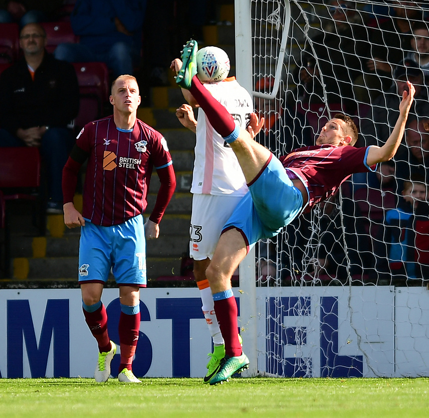 Scunthorpe United's Murray Wallace, under pressure from Blackpool's Colin Daniel, attempts a spectacular shot at goal<br /> <br /> Photographer Chris Vaughan/CameraSport<br /> <br /> The EFL Sky Bet League One - Scunthorpe United v Blackpool - Saturday 9th September 2017 - Glanford Park - Scunthorpe<br /> <br /> World Copyright &copy; 2017 CameraSport. All rights reserved. 43 Linden Ave. Countesthorpe. Leicester. England. LE8 5PG - Tel: +44 (0) 116 277 4147 - admin@camerasport.com - www.camerasport.com