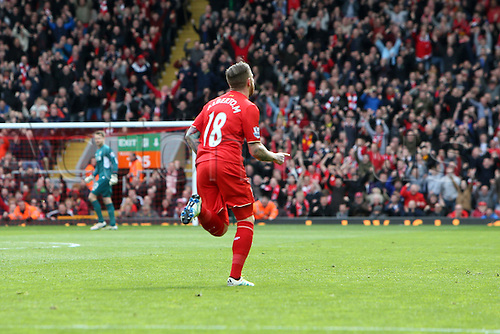 10.04.2016. Anfield, Liverpool, England. Barclays Premier League. Liverpool versus Stoke. Alberto Moreno of Liverpool  turns away to celebrate his opening goal.